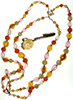"Candy-coloured four-strand Lucite bead necklace signed ""West Germany"